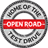 Badge - Home of the Open Road Test Drive